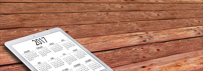 Ipad with calendar on wooden boards